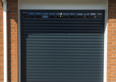 Anthracite roller door with vision profiles and white frame