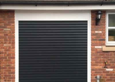 black-single-roller-garage-door-white-frame