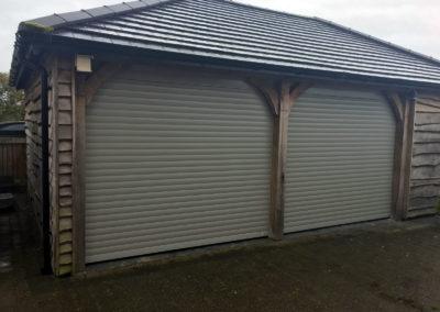 Light Grey roller doors installed on oak framed garage