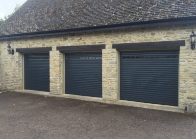 3 Anthracite Roller Doors with vision profiles