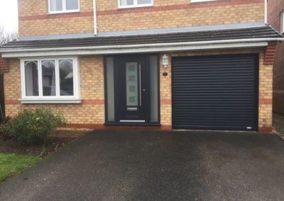 Anthracite roller door with matching frame & front door