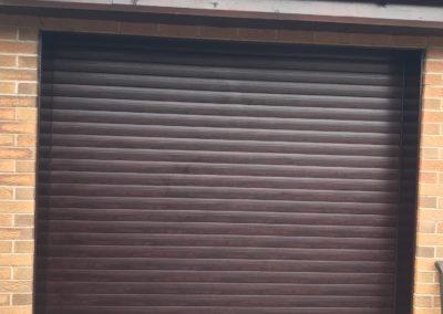 Foiled rosewood roller door