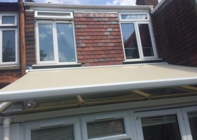 Awning installed above conservatory