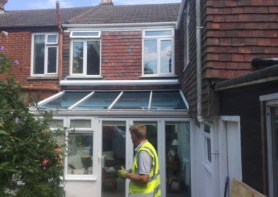 Awning installed above conservatory - white cassette