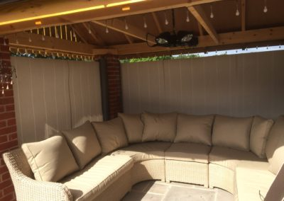 Awning side screens create wind shelter for seating area