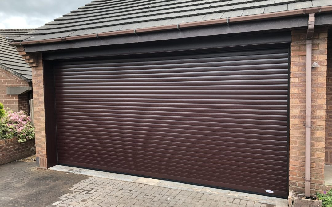 Converting two garage doors into one